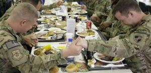 U.S. soldiers stationed in Kabul praying before Thanksgiving supper. Photo credit - http://thechristians.com/?q=node/437